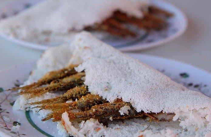 Ginga com tapioca, prato típico da culinária potiguar, é muito apreciada nas praias de Natal — Foto: Canindé Soares/G1