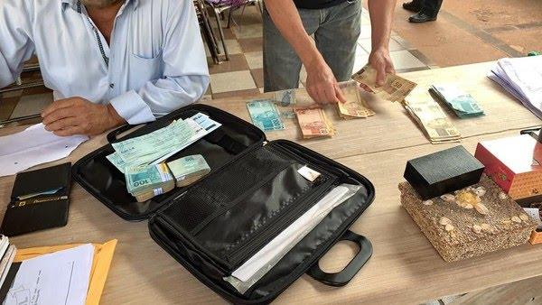 Dinheiro apreendido durante operação Dark Money em cidade de MS  Foto: Polícia Civil/Divulgação